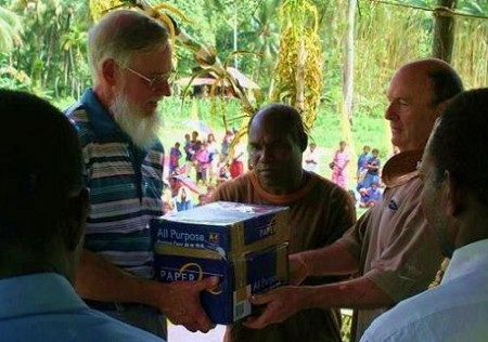 William Butler, Maso the PNG translator and John Pryor receiveing the book of Acts
