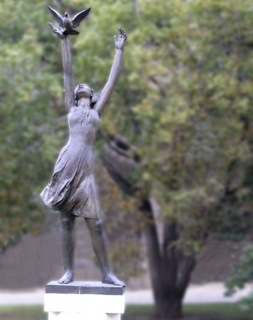 A beautiful statue in Berlin of a young woman releasing a dove (without the distracting scaffolding)