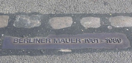 The marker in the street that shows where The Wall was - Berlin