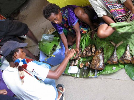 Stinky smoked fish at the market in Madang, Papua New Guinea