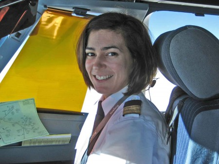 Nuria in her airplane looking happy