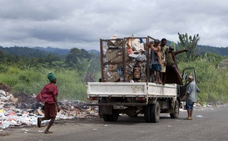 A fresh load of garbage for the pit of filth along the road to Madang