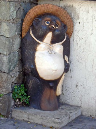 Cute little animal statue in from of a Honolulu Japanese Steak House