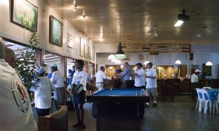 Inside the Madang Club fisherfolk and guests await the return of the boats on day one