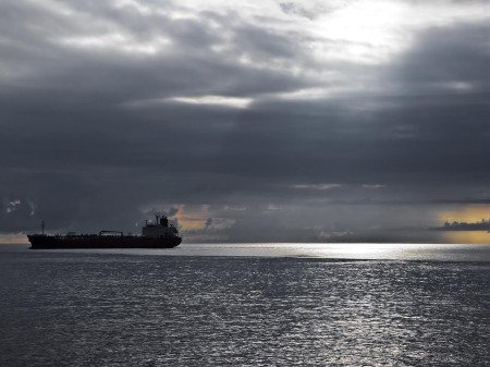 A ship making way toward Madang Harbour at sunrise